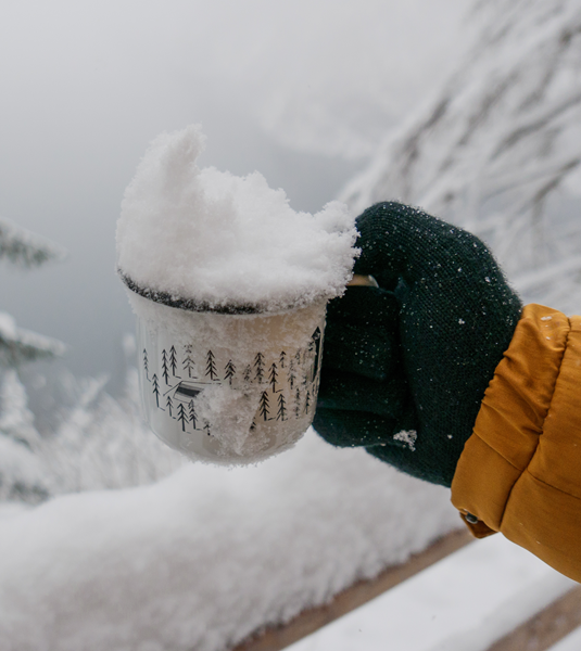 melting snow in a mug